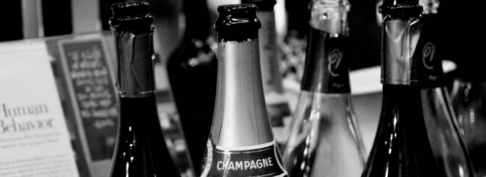 opened-champagne-bottles-slider